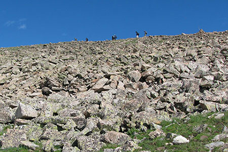 hikers on the ridge of scree