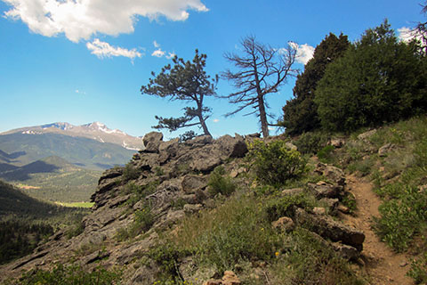 Trail leading to outcropping with view of Longs Peak