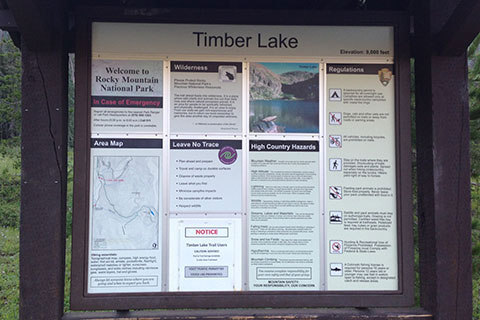 An informative trailhead kiosk for the Timber Lake Trail in Rocky Mountain National Park.